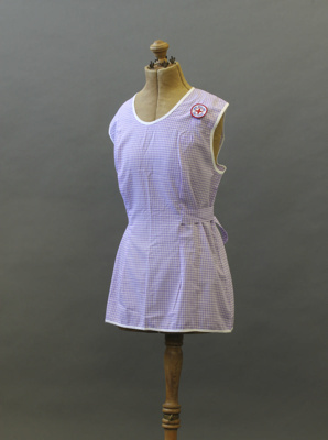 Pinafore; a purple-and-white gingham-patterned pin...