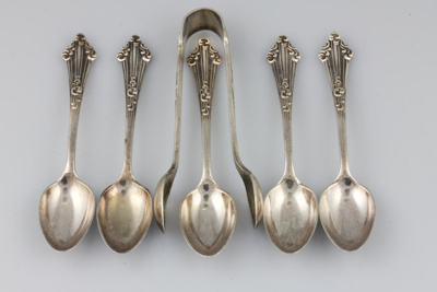 Teaspoon and Sugar Tong set; comprising five elect...