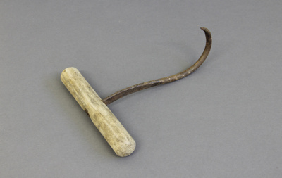 Hook; a wooden-handled single-pronged metal wool b...