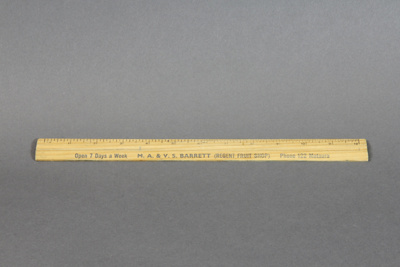 Ruler; a wooden ruler, which was used by Mr Barret...