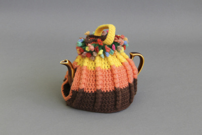 Tea cosy; a hand crocheted woollen tea cosy.