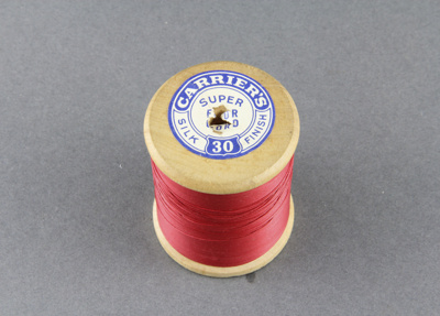 Sewing thread on spool; red cotton.; Carriers; 1940-1950; MT2012.105.2