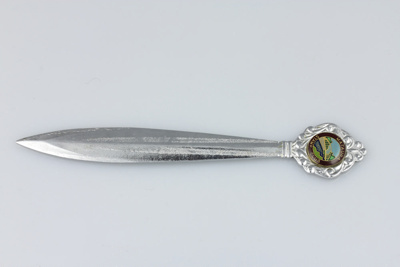 Paper knife, a chromed letter opener with an image...