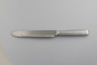 Knife; a stainless steel table knife from Daly's B...
