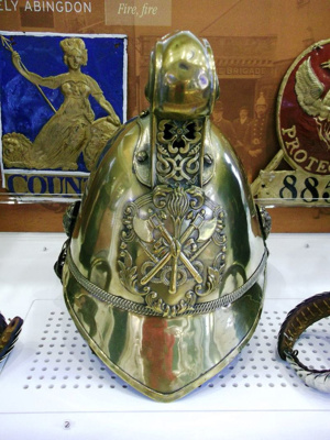 Fire Brigade helmet and epaulettes; Merryweather & Sons Firemans Outfitters, London; Victorian; 1980.96.838 & 853-3