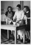 Kenny MacDonald cooking; c1950; 2011.74