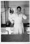 Kenny MacDonald cooking; c1950; 2011.71
