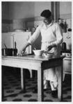 Kenny MacDonald cooking; c1950; 2011.72