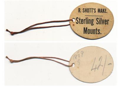 R Shott's Sterling silver mounts Tag; Unknown; 1907 - 1920; NTTUS0405