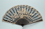 Black folding fan with black machine net leaf applied with bobbin lace.   Sticks inset with sequins. France, c. 1890; LDFAN2014.32