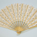 Bamboo folding fan with machine tape 'lace' leaf China for European market, c. 1980; LDFAN2009.67