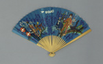 Wooden folding fan with paper leaf advertising BOAC; c. 1950; LDFAN2016.8