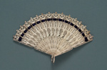 Metal Brisé Fan & Wrapping; c.1980; LDFAN2010.137