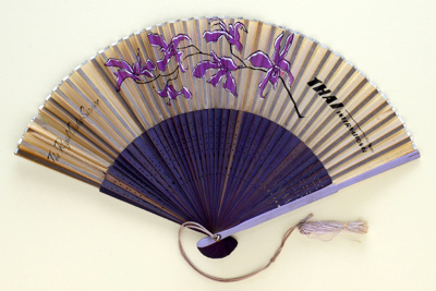 Advertising fan for Thai International Airways, 'Royal Orchid Service'; c.1970; LDFAN2003.407.HA