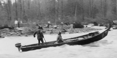 Everett Spalding and Prince Helfrich in a long boat on the McKenzie River Oregon