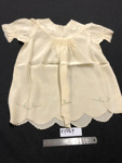 Baby's dress cream; Hand made by donor's mother; 1930s; R17049