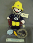 Knitted fireman doll and stand with hose; Kennedy, Kathleen; 2017; R16864