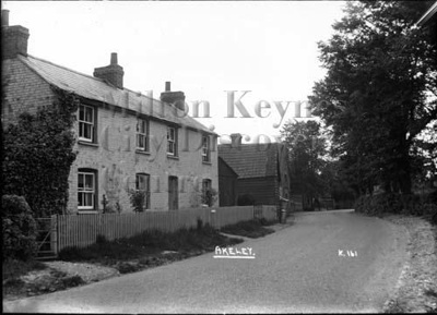 Main Street, Akeley, facing SE. A house known as