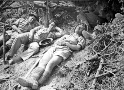 Soldiers resting at the side of a road during World War 2; Unknown; 1940-1945; 6024
