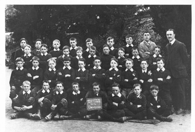School class - boys and master; Unknown; 1912; 24
