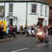 Cycle Tour 2008 with lead rider passing through South Molton; 41-11206