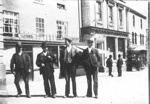 Four Gentlemen on street in Torrington with Devon & Cornwall Bank in background; 186