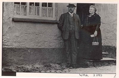 Man and woman at cottage door.; 3290
