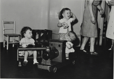 Children playing playgroup, train and tears; 1950; LMA_4314_07_003_0004