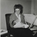 Mother holding newborn baby next to cot; c. 1950; LMA_4314_07_001_0023