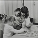 Children doing bus puzzle with nursery worker; c.1970; LMA_4314_07_002_0005