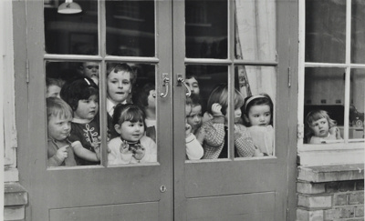 Children looking through french windows from playgroup; 1967; LMA_4314_07_003_0002