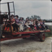 Mothers and children on a farm trailer; c. 1975; LMA_4314_07_001_0001
