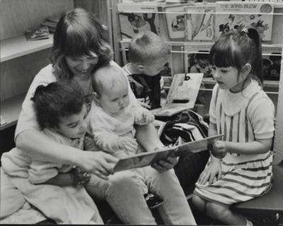 Children reading with nursery worker; c. 1970; LMA_4314_07_002_0006