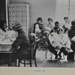 Waiting room for baby clinic, with multi-ethnic mums and babies; c. 1960s; LMA_4314_07_001_0026
