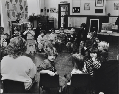 Children in a circle with nursery workers; c. 1970; LMA_4314_07_002_0007