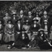 Group of men and women, probably mothers and fathers with children at centre; c. 1920; LMA_4314_07_001_0021