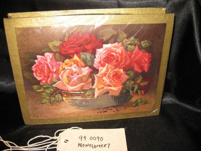Chocolate Box, gold and green chocolate box with a picture of roses in a bowl..