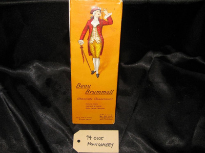 """Chocolate Box: """"Beau Brummell Chocolate Assortment, Distinctive Centres... Coated With An Exquisite...Bitter Sweet Chocolate"""", bright yellow-gold rectangular box inscription on label reads """"beau brummell chocolate assortment, distinctive centres.."""