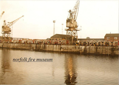 Photograph of fire appliances drawing water from King's Lynn docks; NFMBDM2012.4