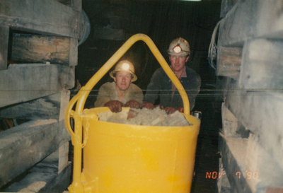 Two miners with kibble of mullock, 'Harry's cross cut' Beaconsfield gold mine; unknown; 07-11-1990; BMHC_14771