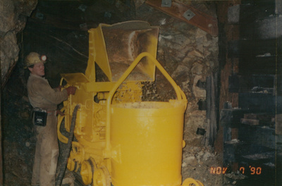 Graham Mahoney operating small underground loader, 'Harry's cross cut' Beaconsfield gold mine; unknown; 07-11-1990; BMHC_14770