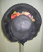 Bonnet, navy Panama straw/silk satin and wool felt flowers; 97.46