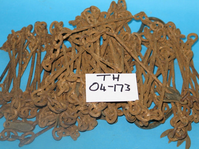 Surveyor's chain. Metal chain with brass handles at each end and brass markers along its length