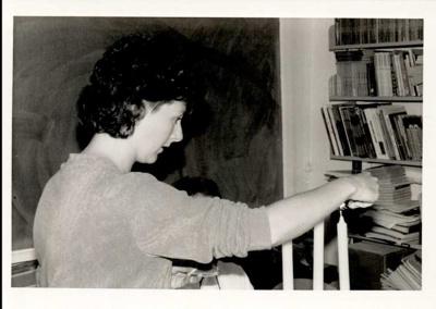 Photographs 1986- Teacher lighting candles; 1986; 110.137