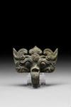 Kaksi T'ao-t'ieh naamiota / Ett par t'ao-t'ieh masker / A pair of T'ao-t'ieh masks; 206 BC-220 AD; DAM6110