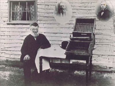 William Tom jr. (c1890) with the gold cradle that he made in 1851. Image courtesy Powerhouse Museum