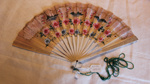 Fan with string of bead attached; Unknown; KMBS 0017.61