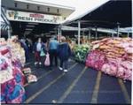 Three people shopping near bags of potatoes ; Mark Wilson; 1998; CCPDM22