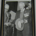 Black& white print of G P Rouchle been helped down stairs by William Edwin Agland MBE.; OWM2015/99