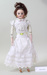 A bisque porcelain doll on pink satin ; Unknown maker; Unknown; CR2019.028